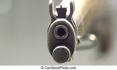 The front of a shot gun in display With its hole infront...