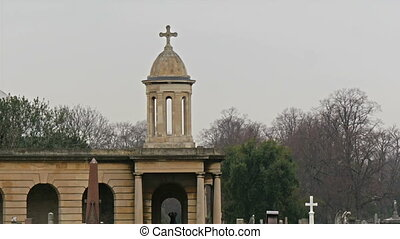 The cross on top of the arch building in a cemetery. The...