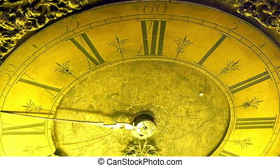 Gold plated old big clock in a museum. The clock has roman...