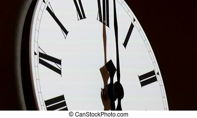 The white wall clock with black hand. The clock has Roman...
