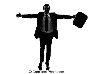 business man running happy arms outstretched silhouette