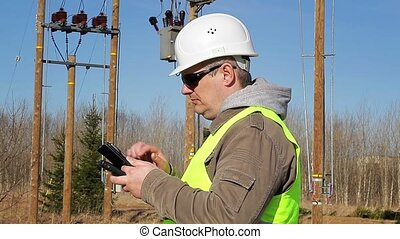 Electrical engineer working with tablet PC