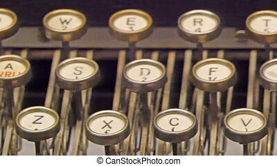 An old model of a typewriter with keys are visible The...