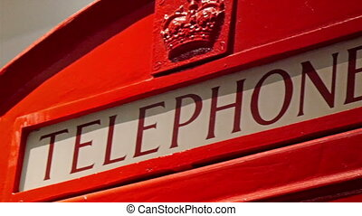 The red and famous telephone booth in London. The booth is...
