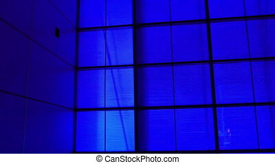 A all blue background in a room. The room filled with blue...