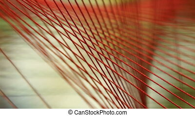 3d Image of a string tied on a cross pattern The red string...