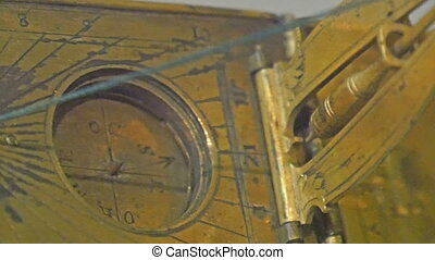 A very old and classic sundial that is gold plated. A...