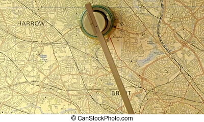 A large map on a table with an old magnifying glass