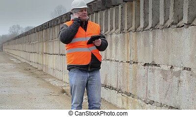 Engineer talking on cell phone