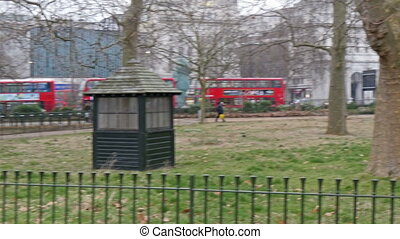 One of the park in London where buses stop nearby Tall trees...