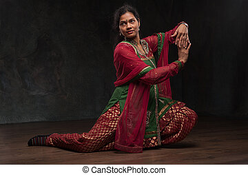 pretty woman in traditional costume - Indian woman dancing...
