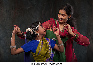 pretty girls in traditional costumes - happy Indian family ,...
