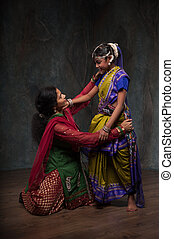 maternal love and care - happy Indian family , mother...