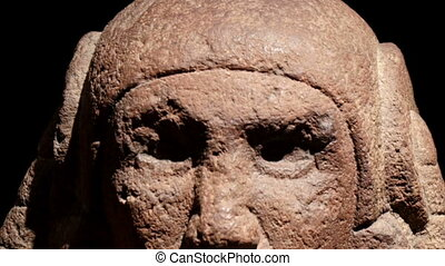 An example of a Mayan Sculpture head. This scupltures are...