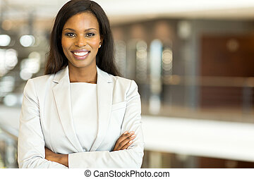 black business executive with arms crossed - attractive...
