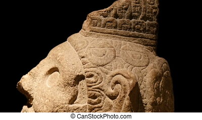 Side view of the Mayan sculptures head. It can be found in...