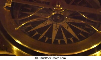 A golden compass used for getting directions A compass is...