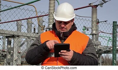 Electrical engineer working with tablet PC at power plant