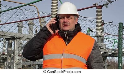 Electrical engineer talking on cell phone