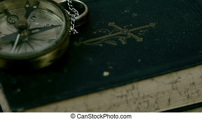 A compass pointing to North and the bible