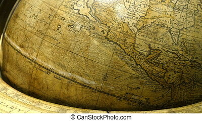 A big brown globe showing the map of North America. This old...