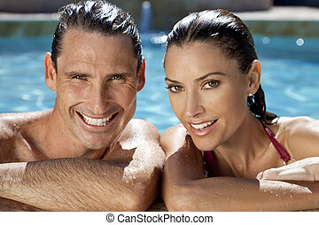 Beautiful Couple Relaxing In Swimming Pool With Perfect...