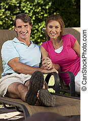 Successful Happy Middle Aged Man and Woman Couple Holding...