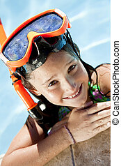 Happy Girl In A Swimming Pool with Goggles and Snorkel - A...