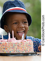 Birthday boy - African American boy next to his birthday...