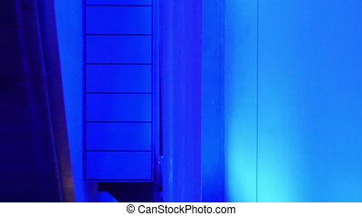 A blue room with a small hallway going through a room.