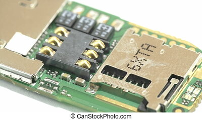 Soldered chips from a USB stick processor Part of the solid...