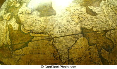 The map of India on a round globe The big round brown globe...