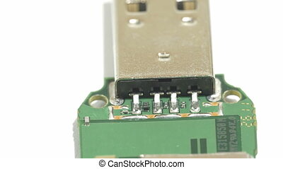 The tip of the USB stick showing the USB port connector The...