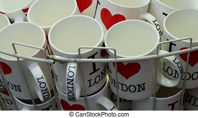 Mugs and coffee cups with I Love London drawing. These are...
