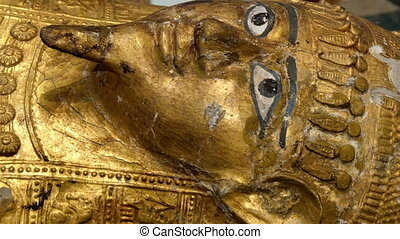 One big golden statue of the Egyptian pharoah. This is an...