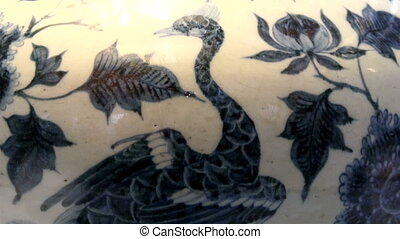 A swan image from a porcelain vase. The blue illustrations...