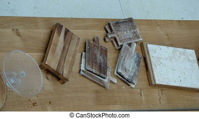 Lots of wooden kitchen chopping boards on the table