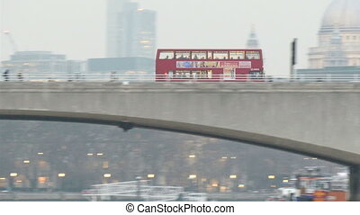 The red bus moving so fast on the bridge in London The...
