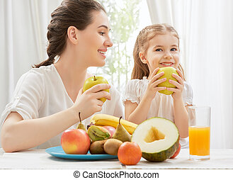 fresh fruit - happy family eating fresh fruit