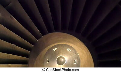 A turbine of the a big airplane. The plane is on standby and...