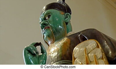 A statue of an old man with green color face