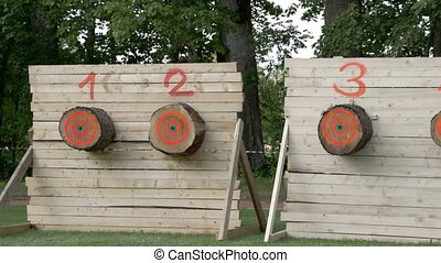 Four big logs on a wall for a competition These logs are...