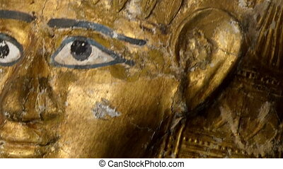 Golden statue of the Egyptian Pharoah with its big eyes and...