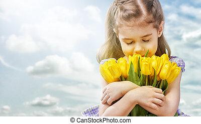 flower girl - little girl and yellow tulips