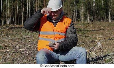 Lumberjack counting euro banknotes