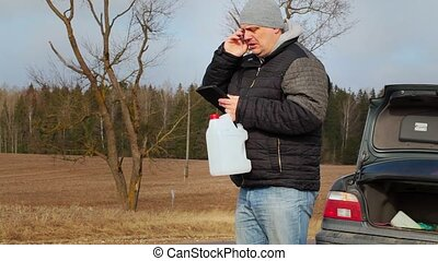 Man with cell phone and empty can