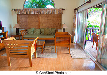 Hawaiian House Decor - Color photographs of the inside of a...