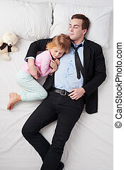 Top view of businessman and his sleeping little daughter -...