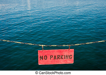 No Parking - A no parking sign in front of the Pacific Ocean