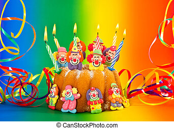 birthday cake with candles and streamer